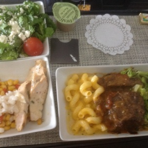 Appetizer - Chicken, an onion, and corn Salad - Greens with cheese and a cherry tomato with balsamic vinaigrette Entree - beef with a mustard demiglaze, mac and cheese, and steamed brocoli