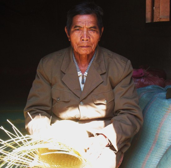 Laotian Man weaving basket