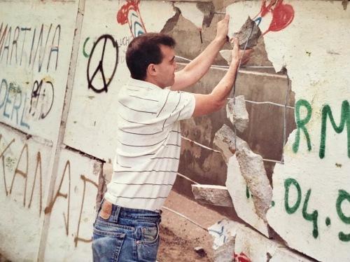 Tearing down Berlin Wall
