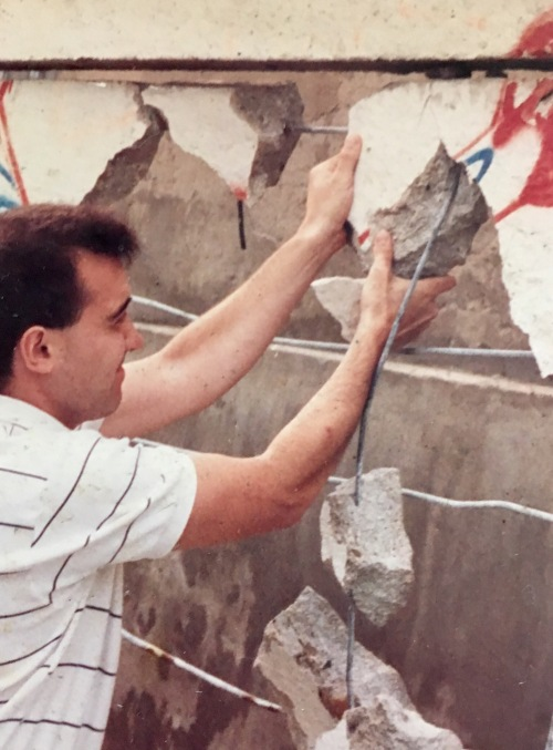 tearing down piece of Berlin Wall